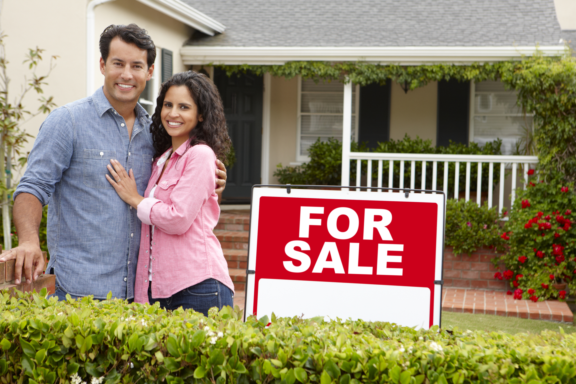 Buy and hold investing, couple outside new house