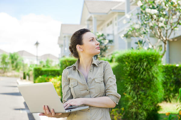 Real Estate Investing, woman looking at property