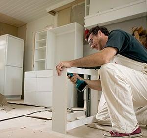 man building a cupboard.